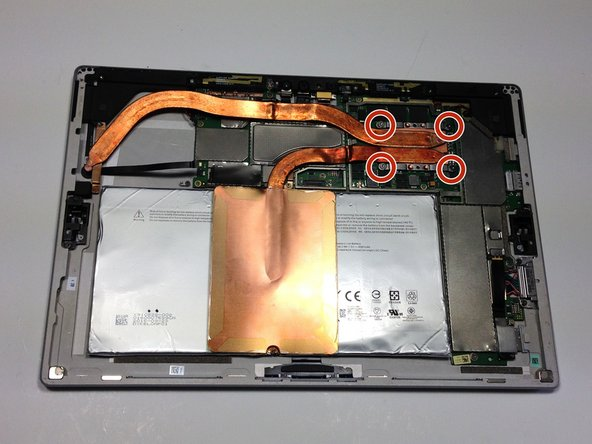 Remove the four 1.5mm Torx T5 screws  holding the main body of the heat sink to the motherboard