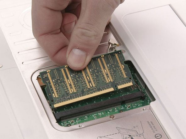 Pull the chip directly out from its connectors.