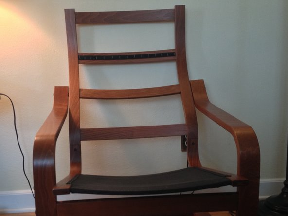Start by removing the seat cushion from the frame.