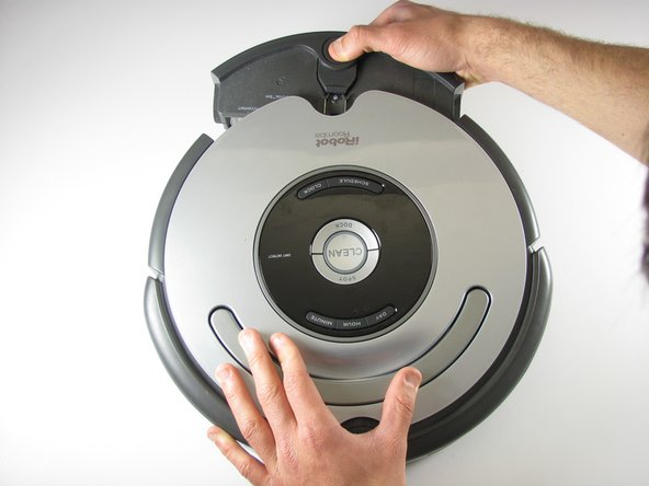 Grasp the back of the Roomba