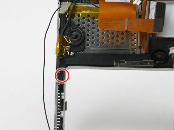 Remove the black Phillips screw on the bottom corner of the left speaker board.