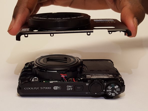 Carefully remove front cover of the camera.