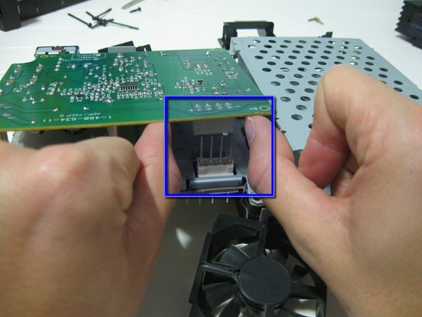 Looking from the back, pull up the board, releasing from the pins of the main board.