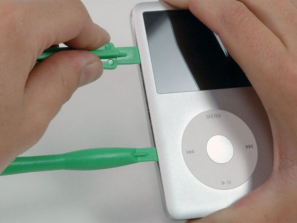 Insert another plastic opening tool into the seam between the front and back of the iPod, leaving at least 1.5 inches of space between the two tools.