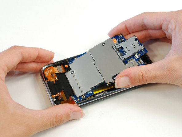 Removing the logic board. Like the 3G, there is a single large PCB with all components.