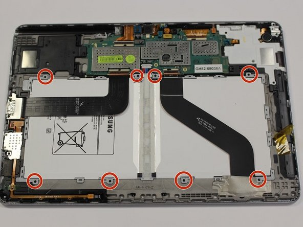 Remove the eight 3mm Phillips #00 screws surrounding the battery.