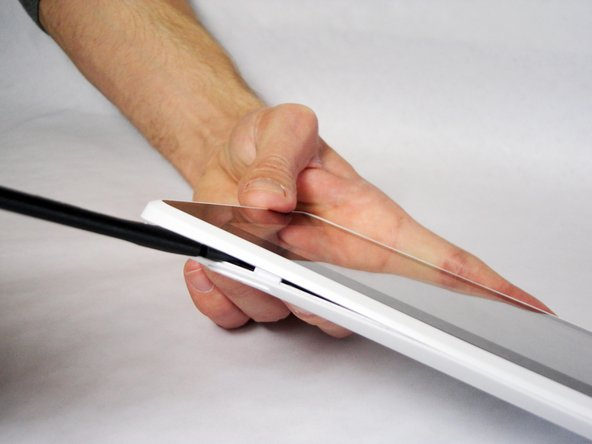 Carefully insert a Spudger into one of the corners of the tablet.