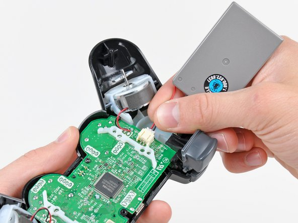 Carefully pull the battery connector away from its socket on the motherboard.