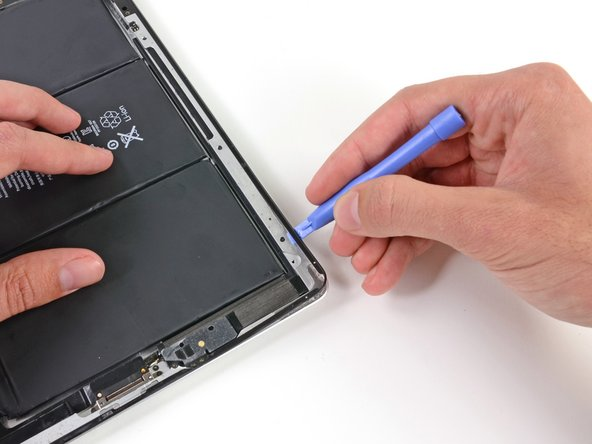 Continue sliding the plastic opening tool along the right edge of the iPad.