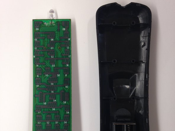 Detach the circuit board from the bottom half of the remote casing.
