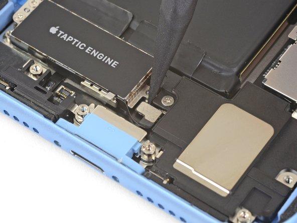 Use a spudger to disconnect the Taptic Engine flex cable by prying it straight up from its socket.