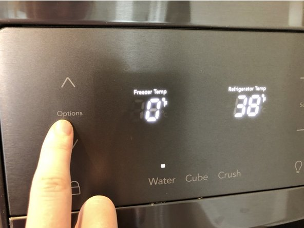 Click options on the control panel on the front of the left door.