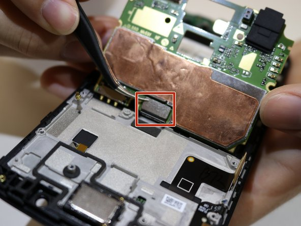 Unplug the back connector from the motherboard using tweezers.