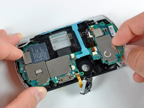 The logic board is still connected to the display, so do not fully remove it from its housing!