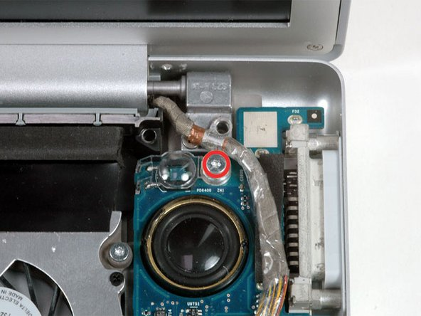 Remove the single T6 Torx screw securing the clear plastic shield over the right ambient light sensor.