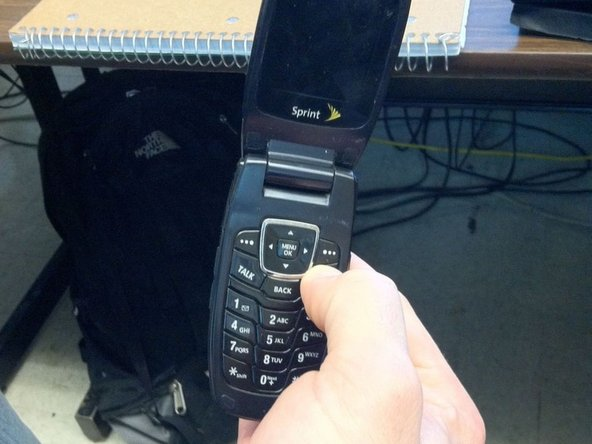 """Press and hold the """"End"""" button until the phone powers off."""