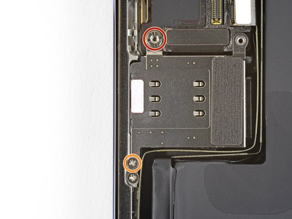 Remove the two screws securing the SIM card reader.