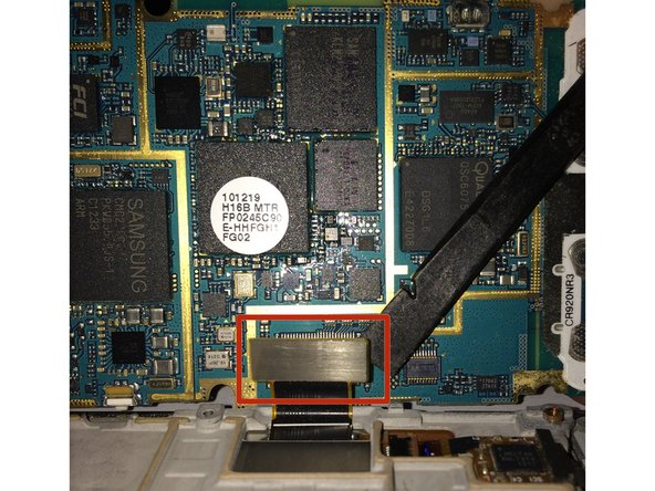 Using your spudger/plastic pry tool, disconnect the LCD/Digitizer flex cable.