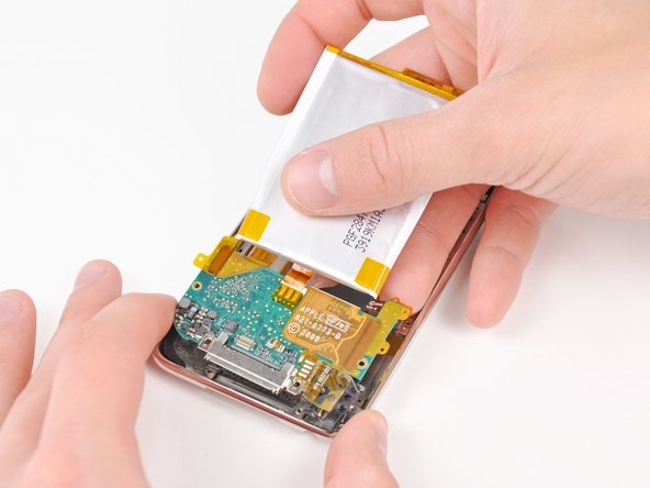Carefully pull the lower logic board away from the lower edge of the rear panel.