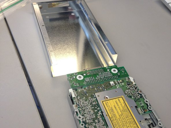 Slide disk drive out of metal casing.