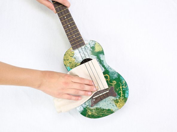 Clean the ukulele with a paper towel or cloth. Make sure to clean around the bridge and the tuners.
