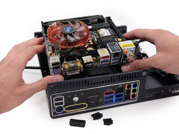 Out comes the entire off-the-shelf Mini-ITX motherboard.