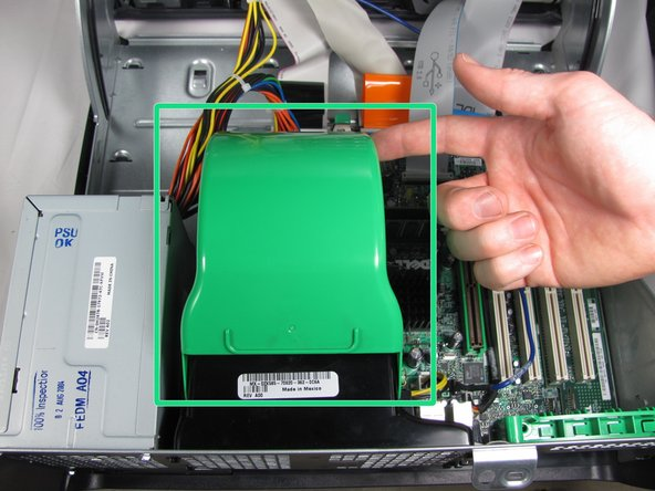 Flip the green fan cover up towards you to reveal the CPU heatsink.