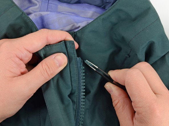 Use tweezers to remove any remaining pieces of the stop from the garment.