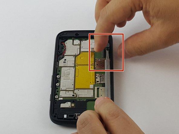 Next remove the plastic C-shaped black plastic frame.
