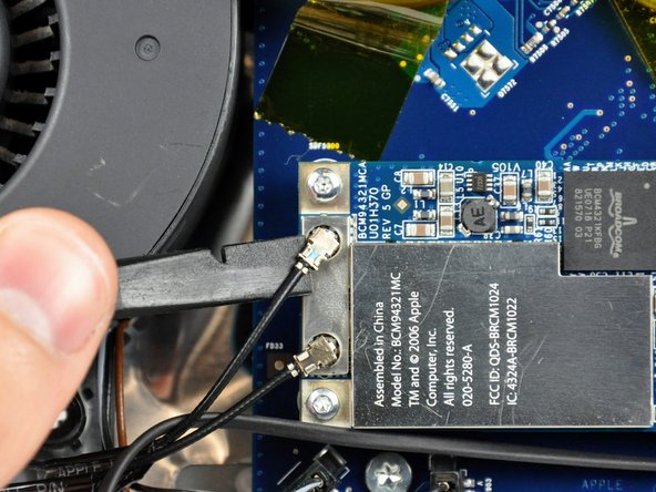 Use the flat end of a spudger to pry both antenna connectors up off the AirPort Extreme card.