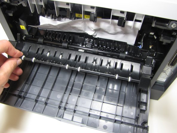 If jammed paper is visible, grab onto the top of the paper and pull up until completely removed from printer.