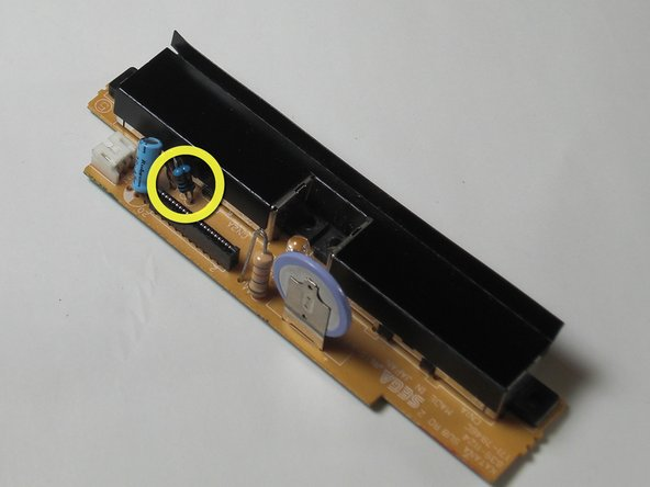 Remove the F1 fuse by using the soldering iron and desoldering wick.