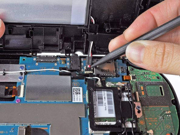 Free the battery cable by gently prying up on the connection with a spudger.