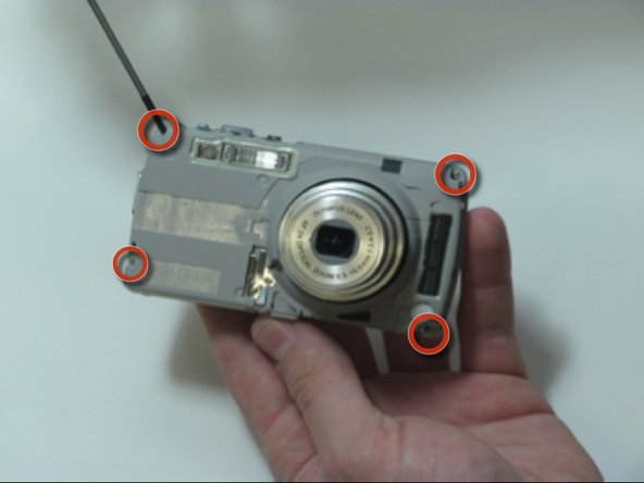 Remove the 4 screws on the inner face of the camera.
