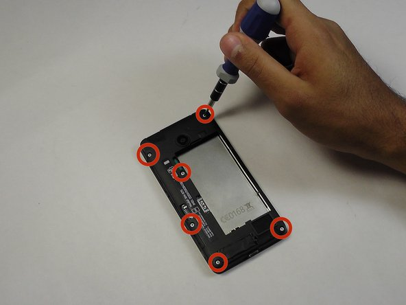 Remove the six screws shown in the photo using the torx Screwdriver 5mm.