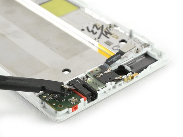 Use a spudger to disconnect the headphone jack flex cable.