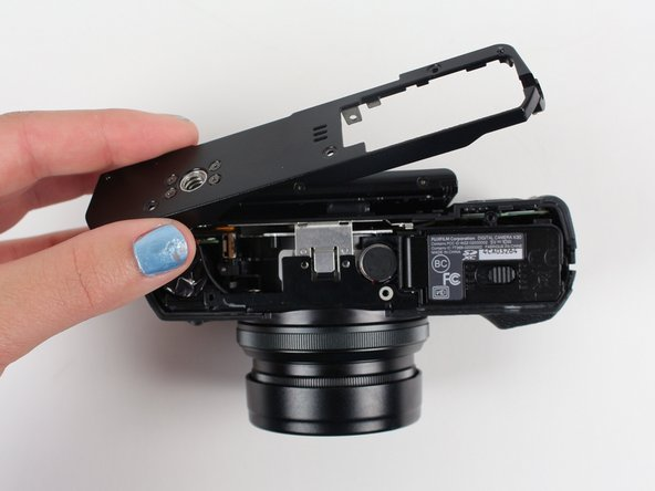 Carefully remove the bottom piece of the camera.