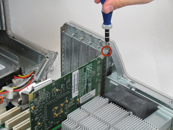 Start by removing the screw holding the card to the chassis as shown.