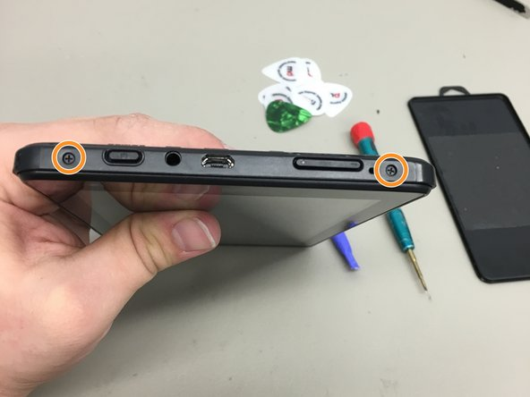 remove the two screws on the top of the device with a PH000 screwdriver