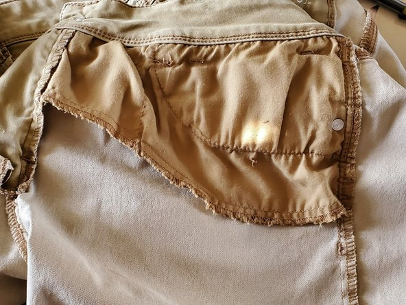 Flip the pants inside out to reveal the pocket you will be extending.