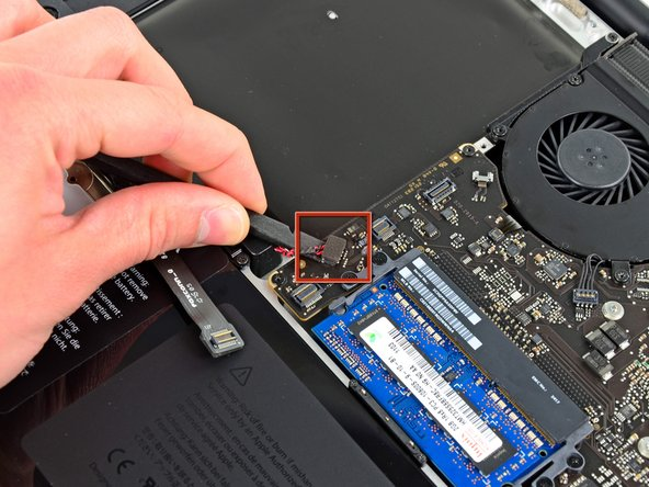 Using the flat end of a spudger, pry the subwoofer connector straight up off the logic board.