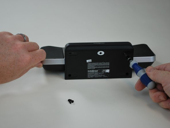Unscrew the six 11mm screws with a Phillips head screw driver.