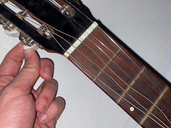 Restring the guitar.