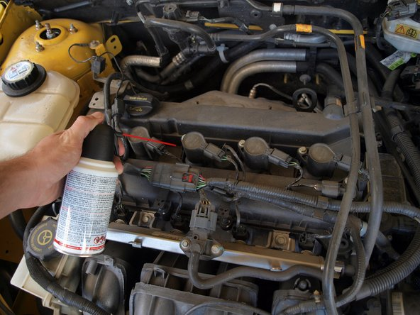 Use compressed air to clear any debris from the area around the ignition coils on top of the engine.