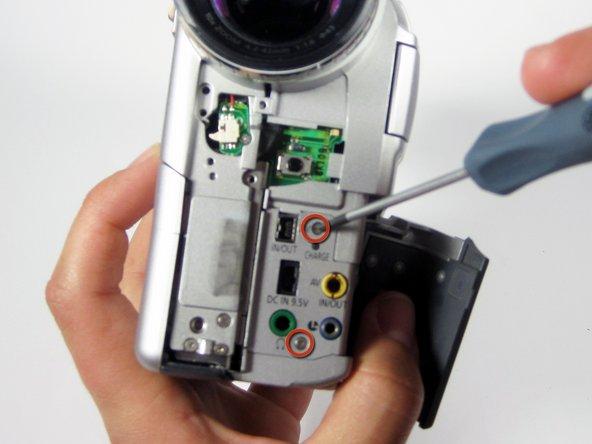 Remove 2 Philips #00 4mm screw shown.