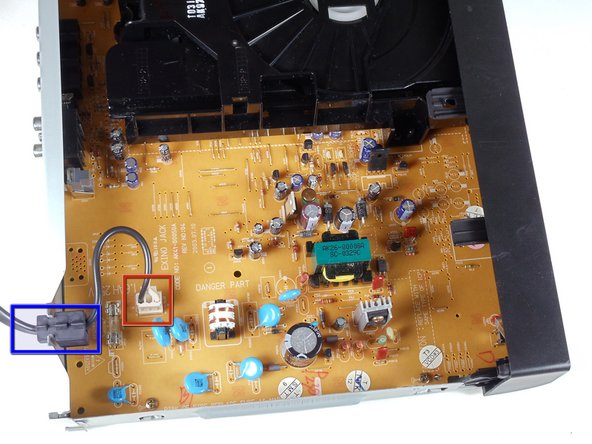 Locate the white clip that attaches the cord to the motherboard