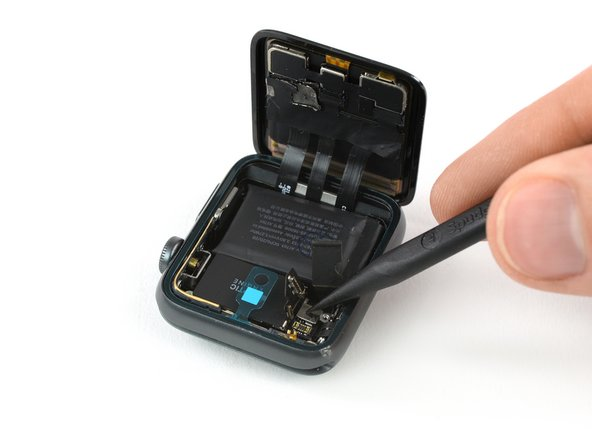 Use a pry tool to fold the connector plate of the Force Touch gasket down into its recess.