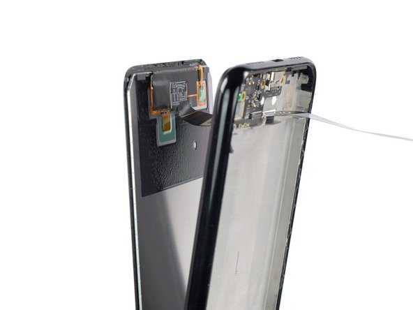 Thread the display flex cable through the gap in the midframe and remove the screen.
