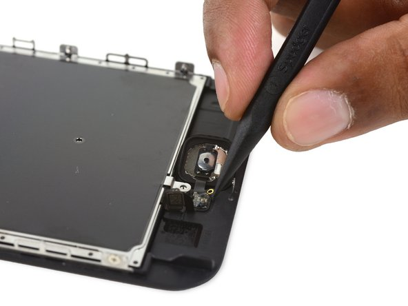 Use the pointed end of a spudger to pry the lightly-adhered home button flex cable off the display assembly.