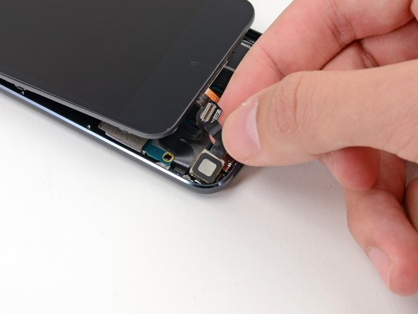 Lift the rear-facing camera up out of its socket and remove it from the iPod Touch.
